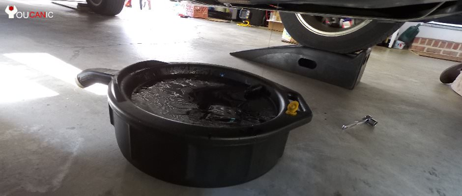 oil drain pan on of the most common tools needed to fix cars yourself