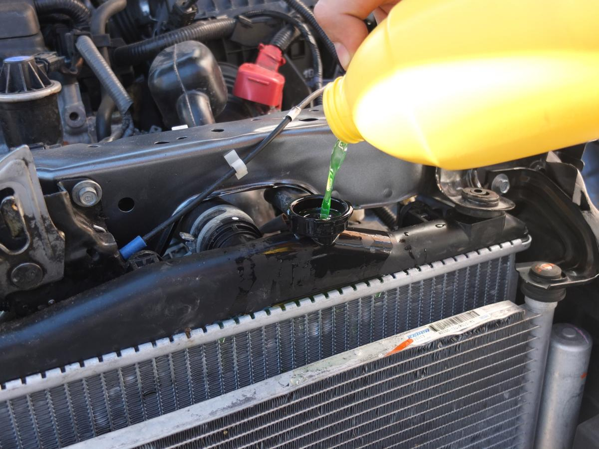 Add engine coolant to fix engine overheating