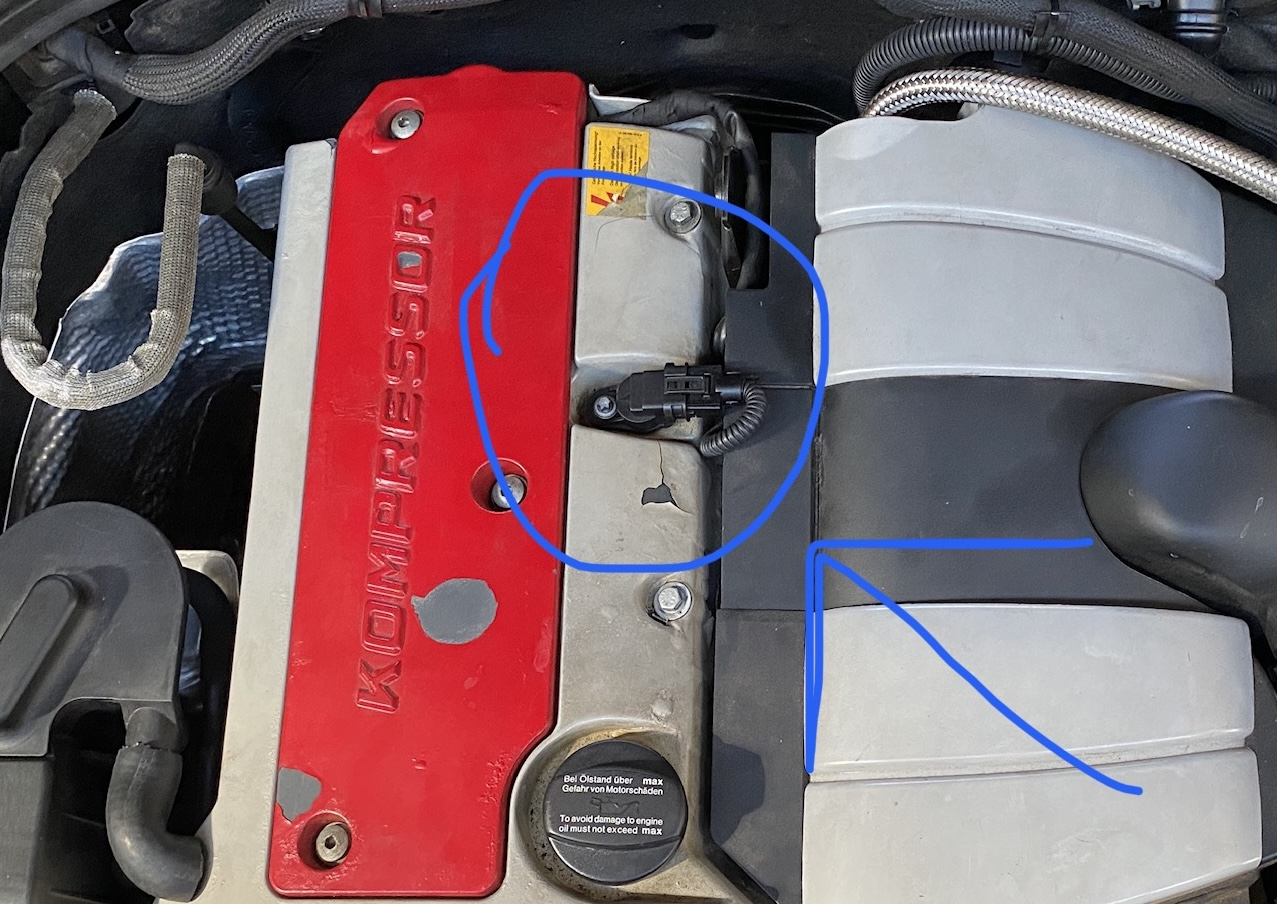 Top view of a motor is shown, with the a sensor circled.