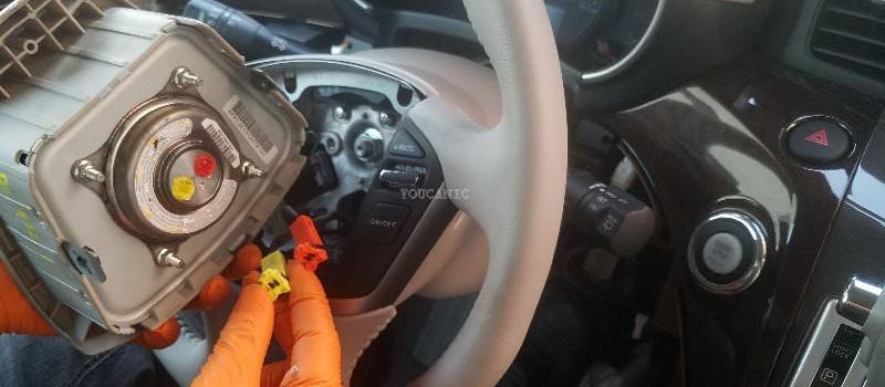 How to Replace Driver Steering Wheel Airbag on Nissan Quest