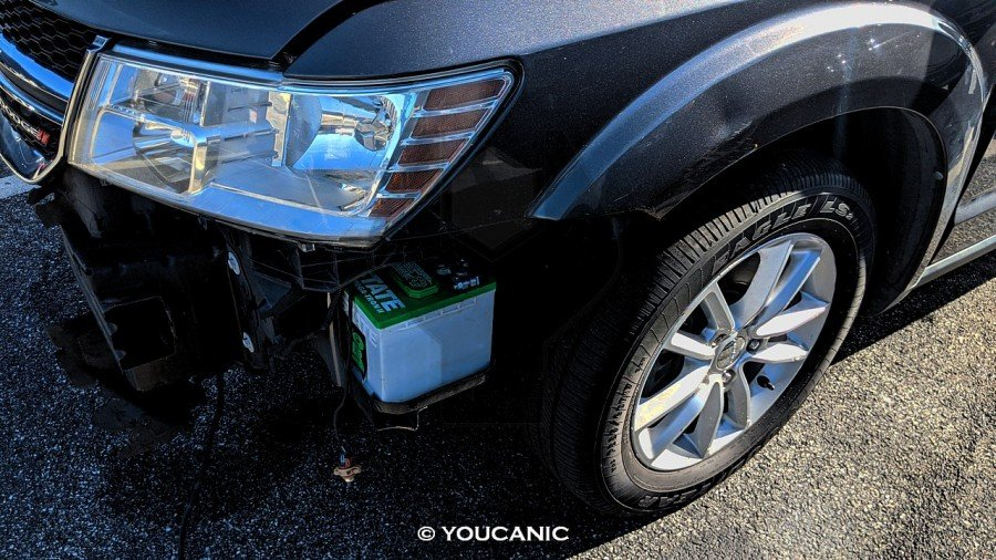 location of the battery on a dodge journey