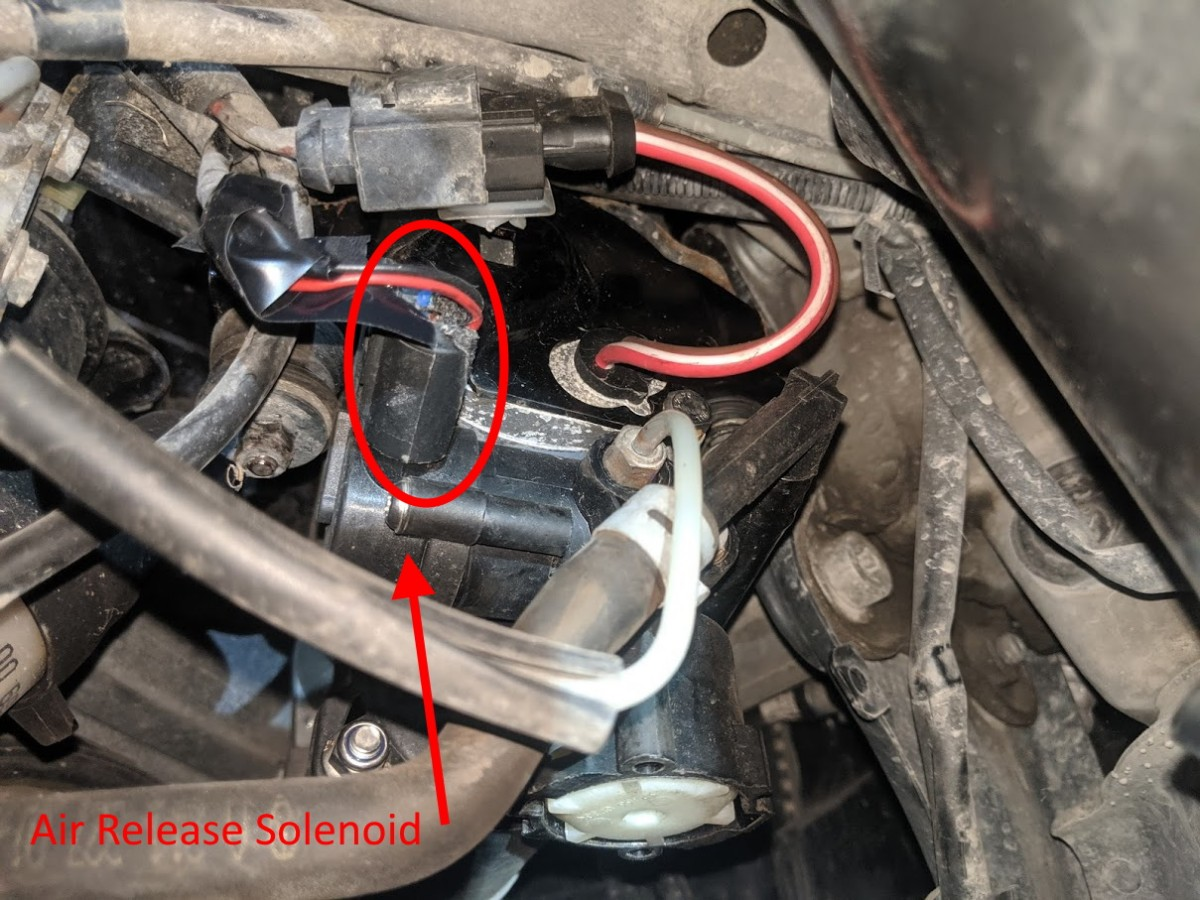 remove air suspention air release valve wire harness