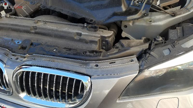 remove grill from bmw place top radiator support on the engine