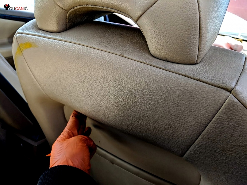 how to adjust remove Volvo head rest
